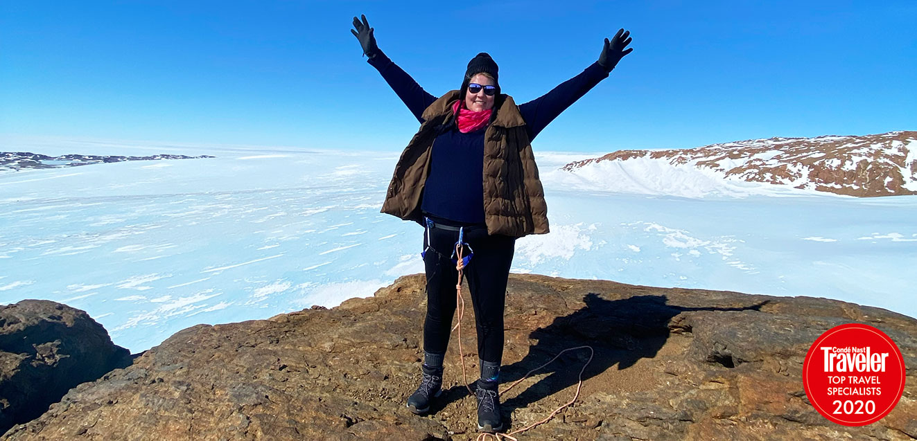 Kate Doty at the summit of a nunatak in Antarctica