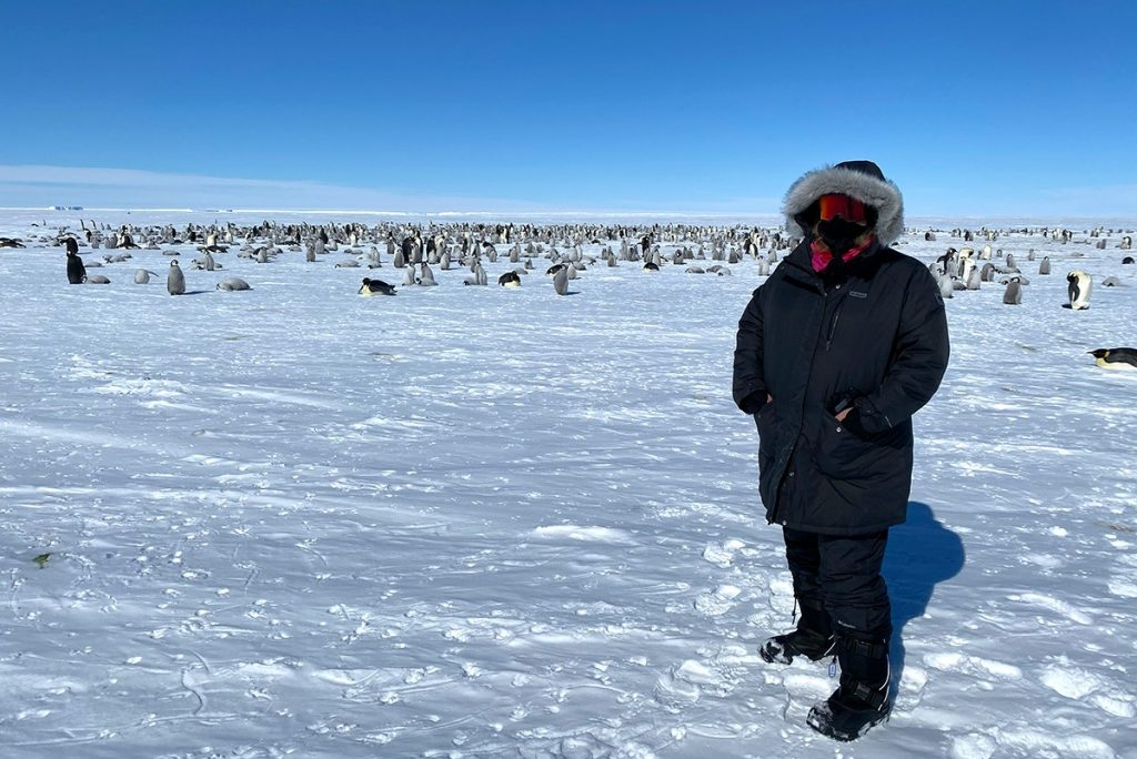 Kate Doty with thousands of penguins.