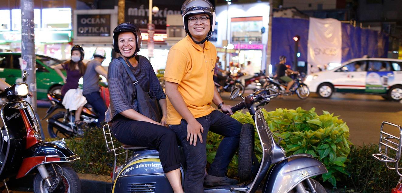 Exploring Vietnam by vespa.
