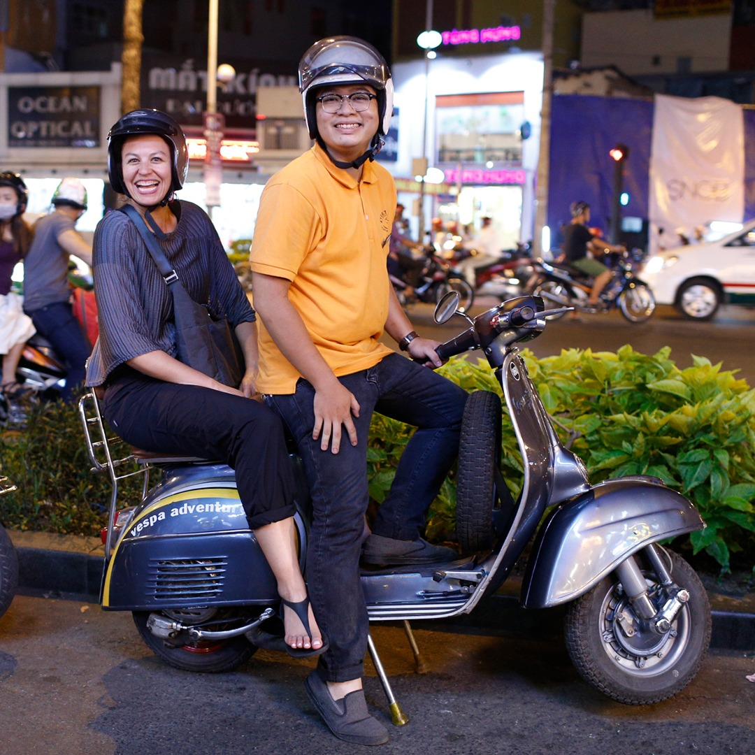Exploring Vietnam by vespa.