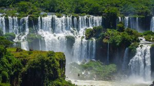 Water cascades down through rain forest vegetation at Iguaza Falls, Argentina