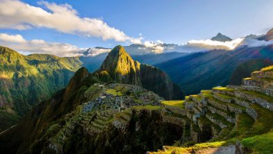 The suns rays shine on the Incan site of Machu Picchu, Peru