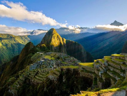 The suns rays shine on the Incan site of Machu Picchu, Peru