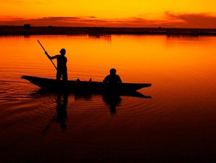 Fisherman on Tam Giang Lagoon, Vietnam