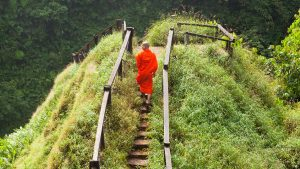 A monk at Tad Yeung waterfall on the Bolaven Plateau, Laos.