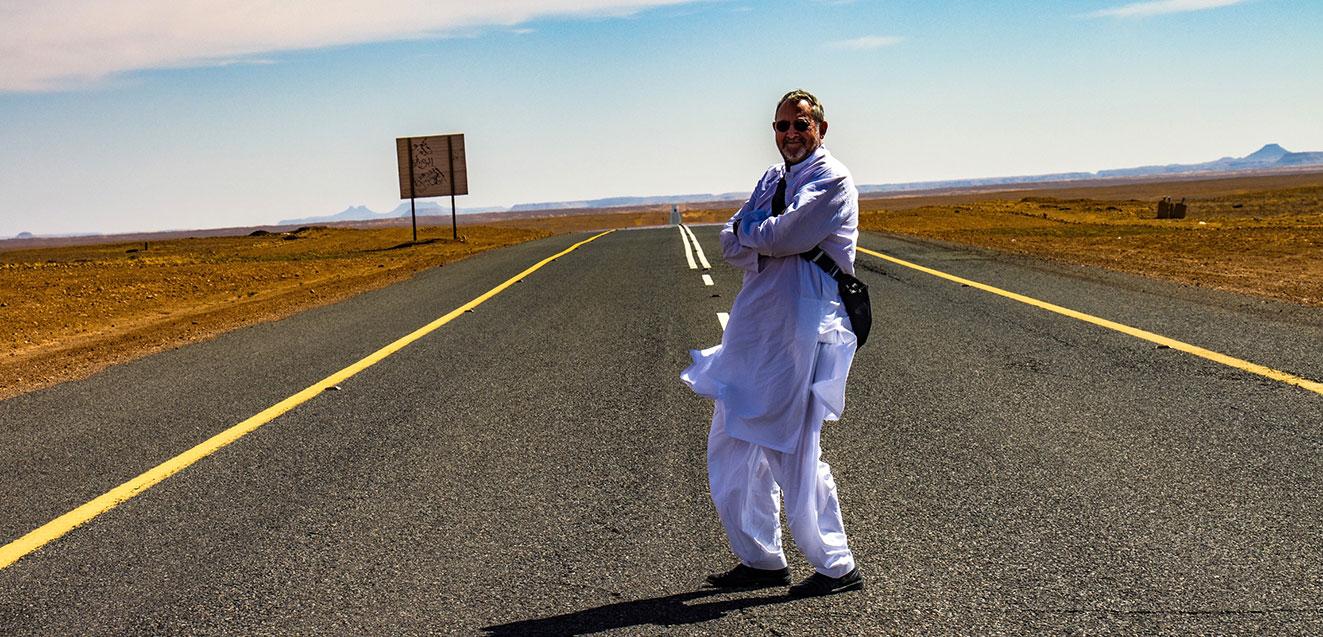 GeoEx trip leader Bill Jones on a road in Saudi Arabia