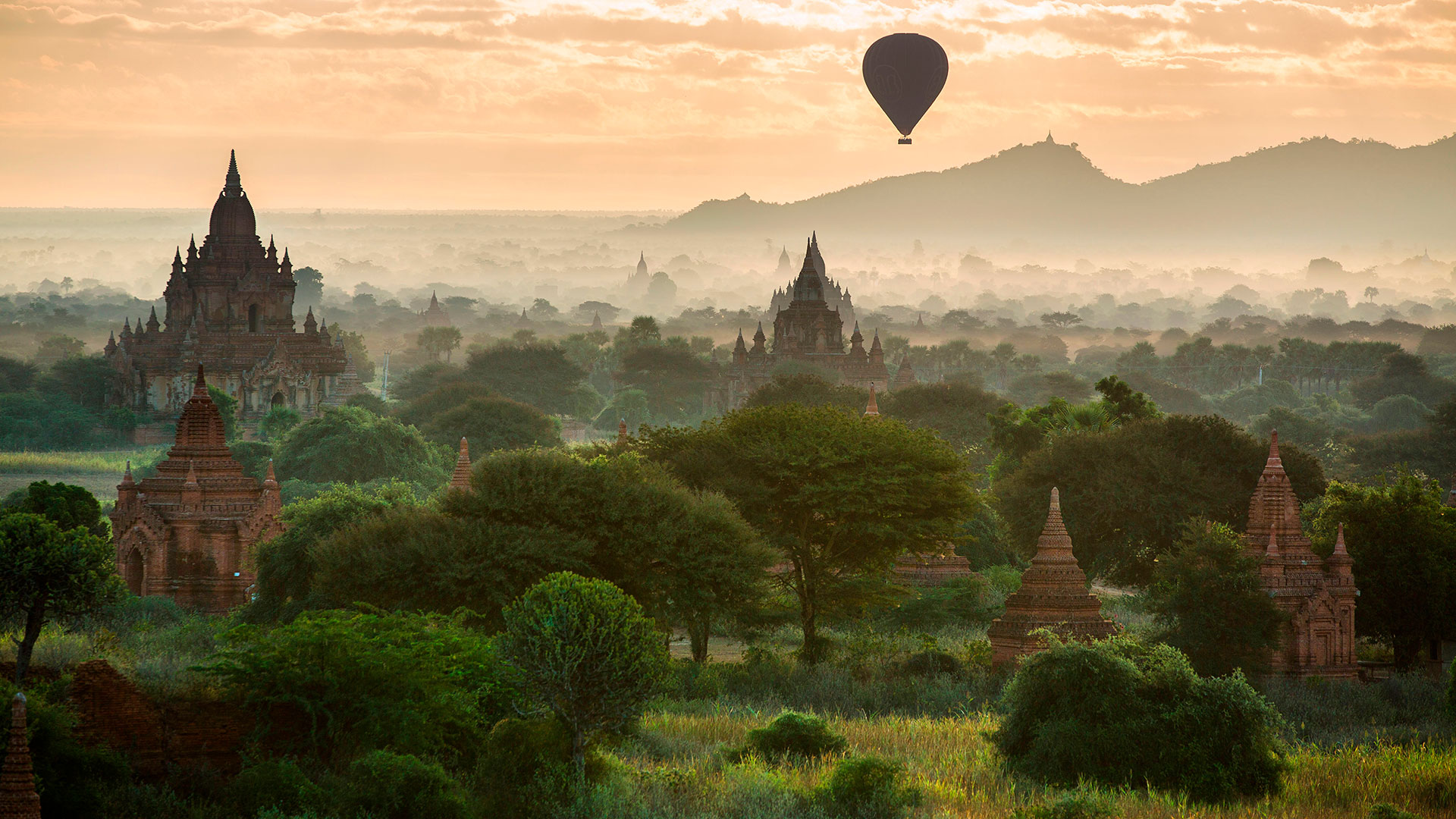 Balloons over the temples of Bagan at dawn, Myanmar