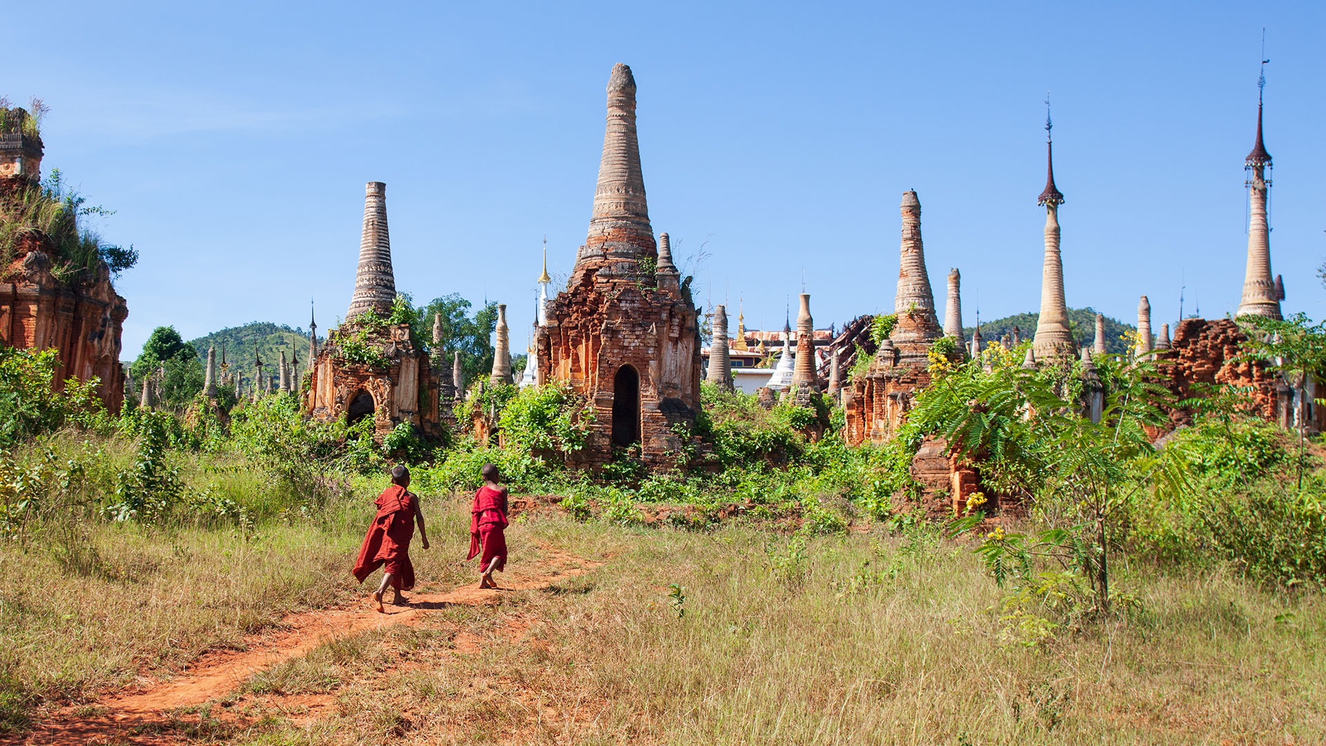 Young monks wander the Plain of Temples in Bagan, Myanmar