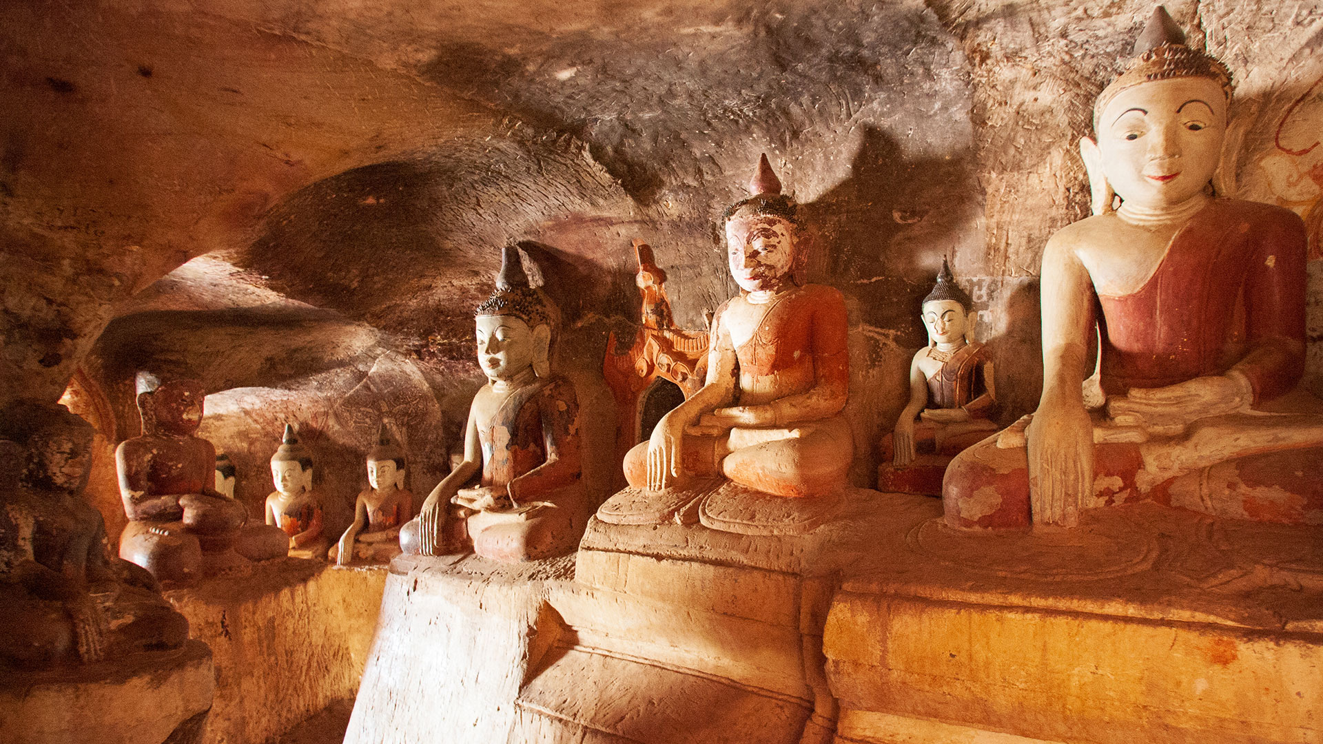 Carved buddhas in cave, Myanmar