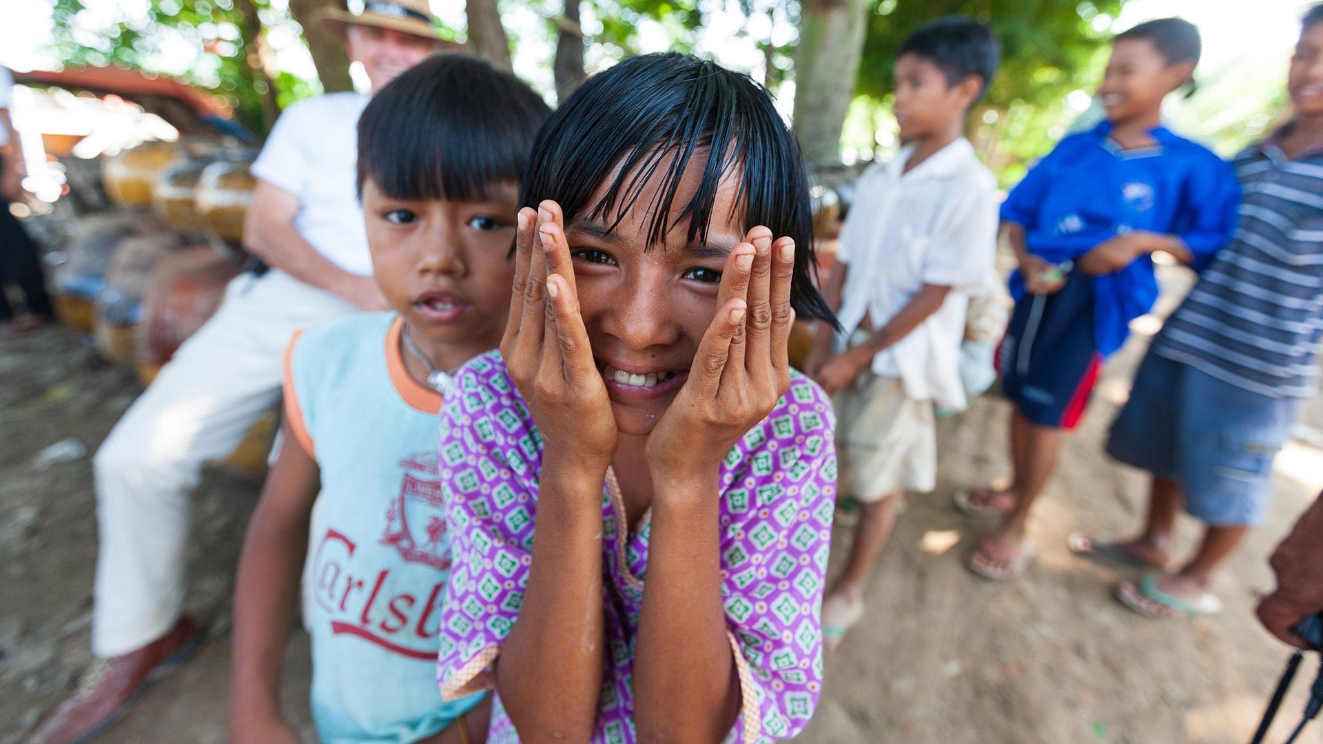 Young children watching street festival in Myanmar