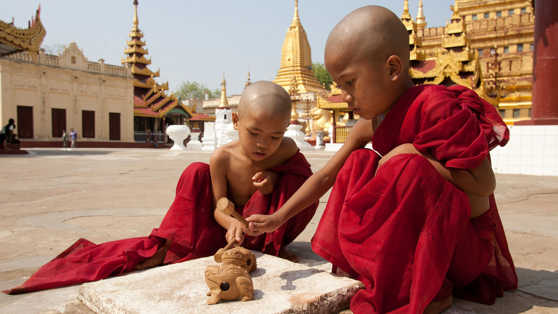 Young monks playing in temple complex, Myanmar