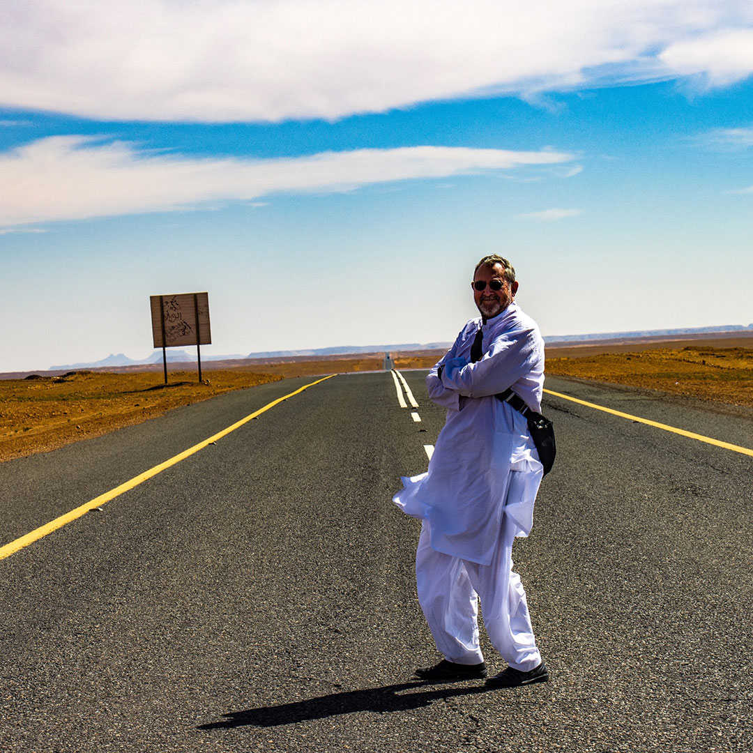 GeoEx trip leader Bill Jones on a road in Saudi Arabia