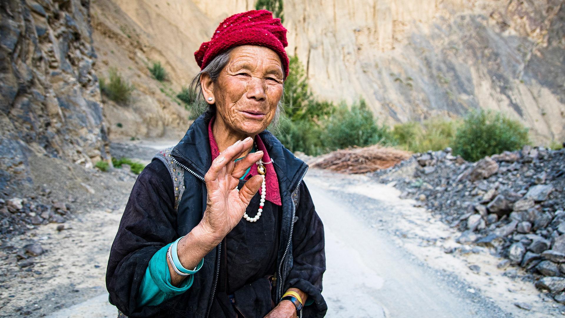 Local woman on Mangyu Gorge road, Ladakh, India