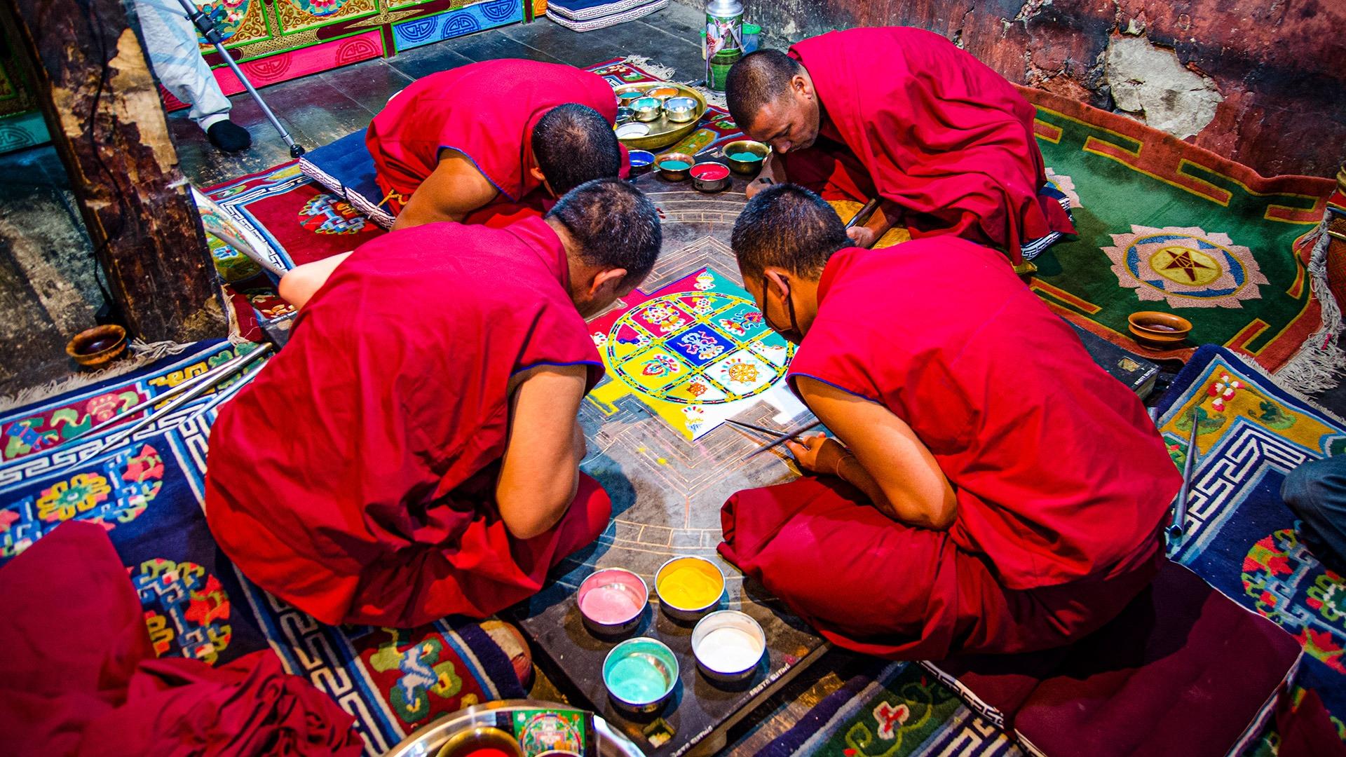 Monks painting a mandala in Ladakh, India