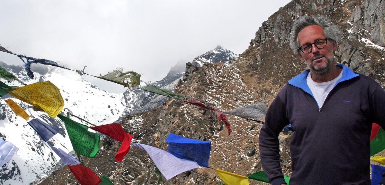 GeoEx Trek Leader Bart Jordans at Gangkhar Puensuum base camp in Bhutan