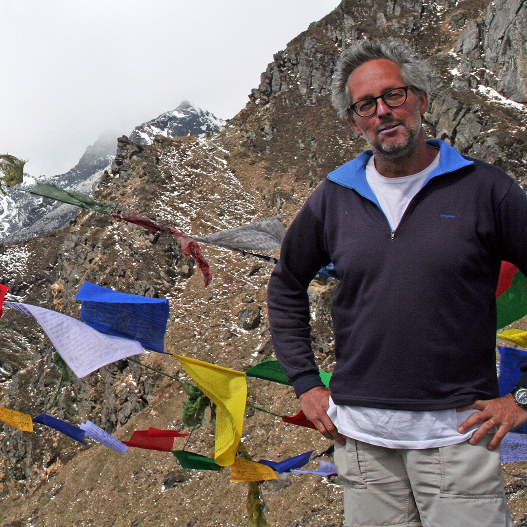 GeoEx Trek Leader Bart Jordans at Gangkhar Puensuum base camp in Bhutan