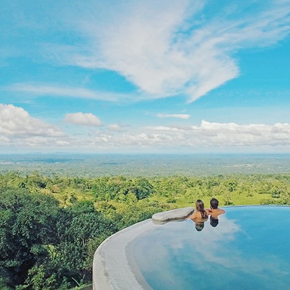 Couple in infinity pool at Origins Lodge, Costa Rica