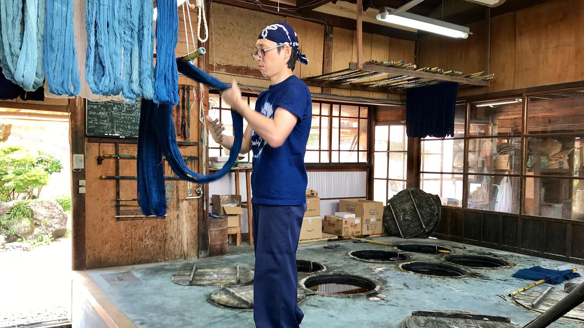 Fifth generation indigo dyeing artist in his workshop in Matsue, Japan
