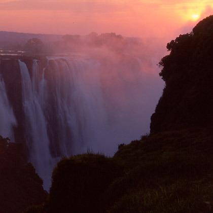 Sunrise in the mist at Victoria Falls, Zimbabwe
