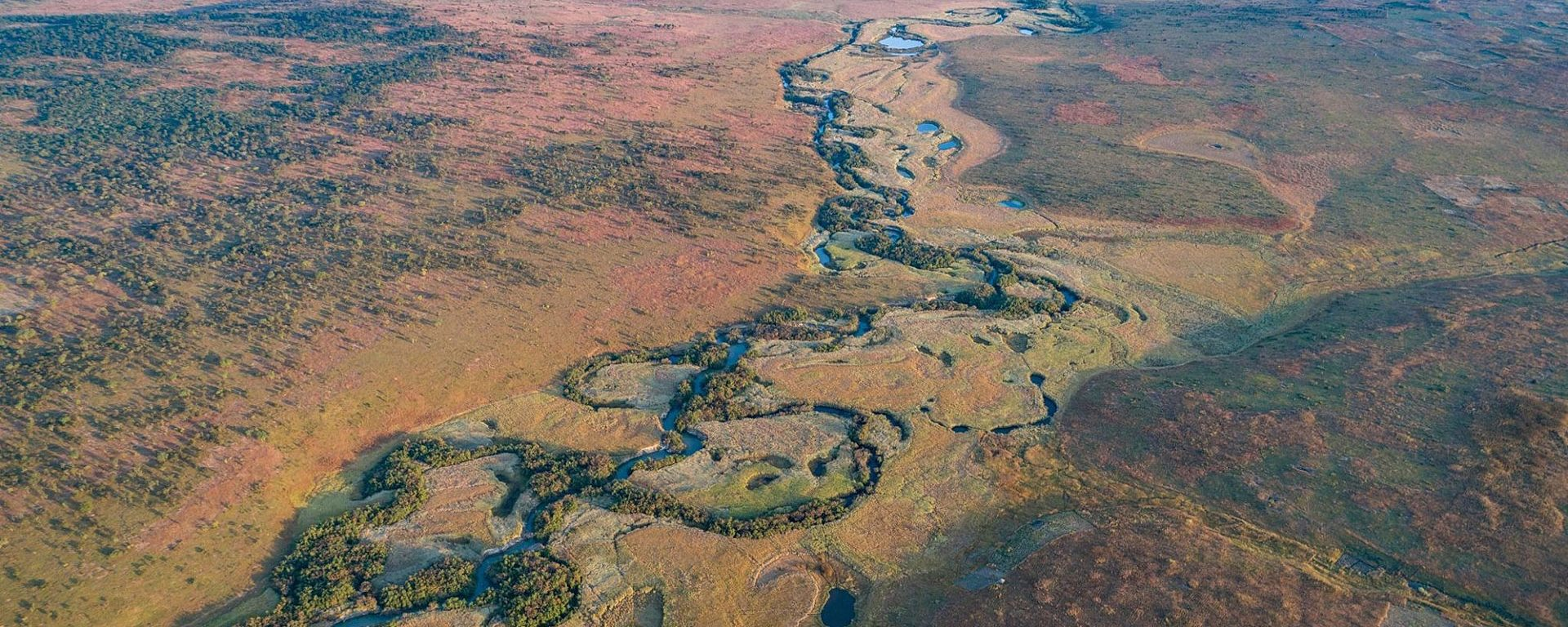 Aerial view of a winding river in the source lakes region of Angola