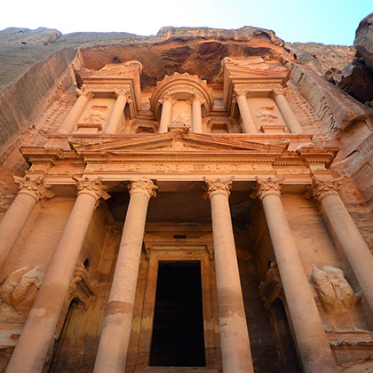 Looking up at the columns and carvings of the Treasury in Petra, Jordan