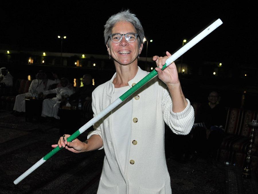 GeoEx Trip Leader Tese Wintz Neighbor at a traditional dance performance in Saudi Arabia
