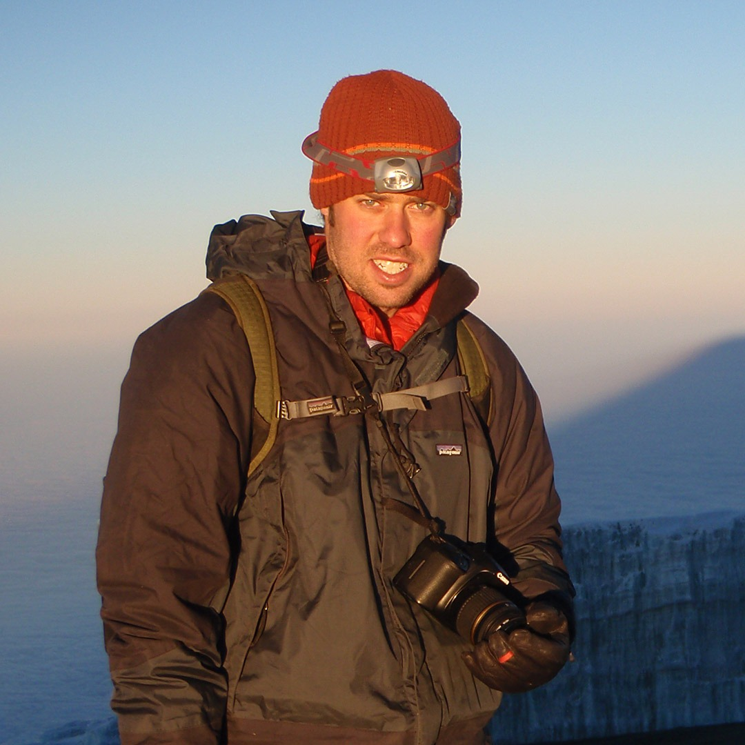 GeoEx CEO Brady Binstadt on the summit of Mount Kilimanjaro, Tanzania