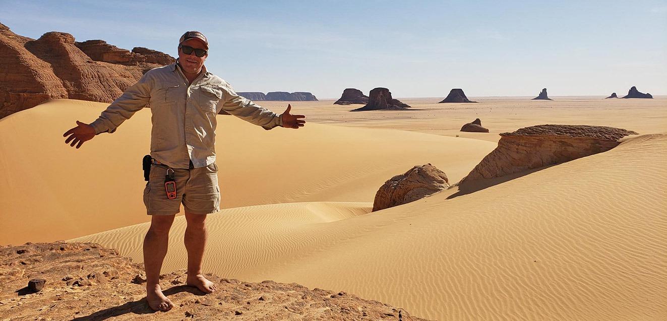 GeoEx trip leader Brad Hansen in the Ennedi Desert, Chad