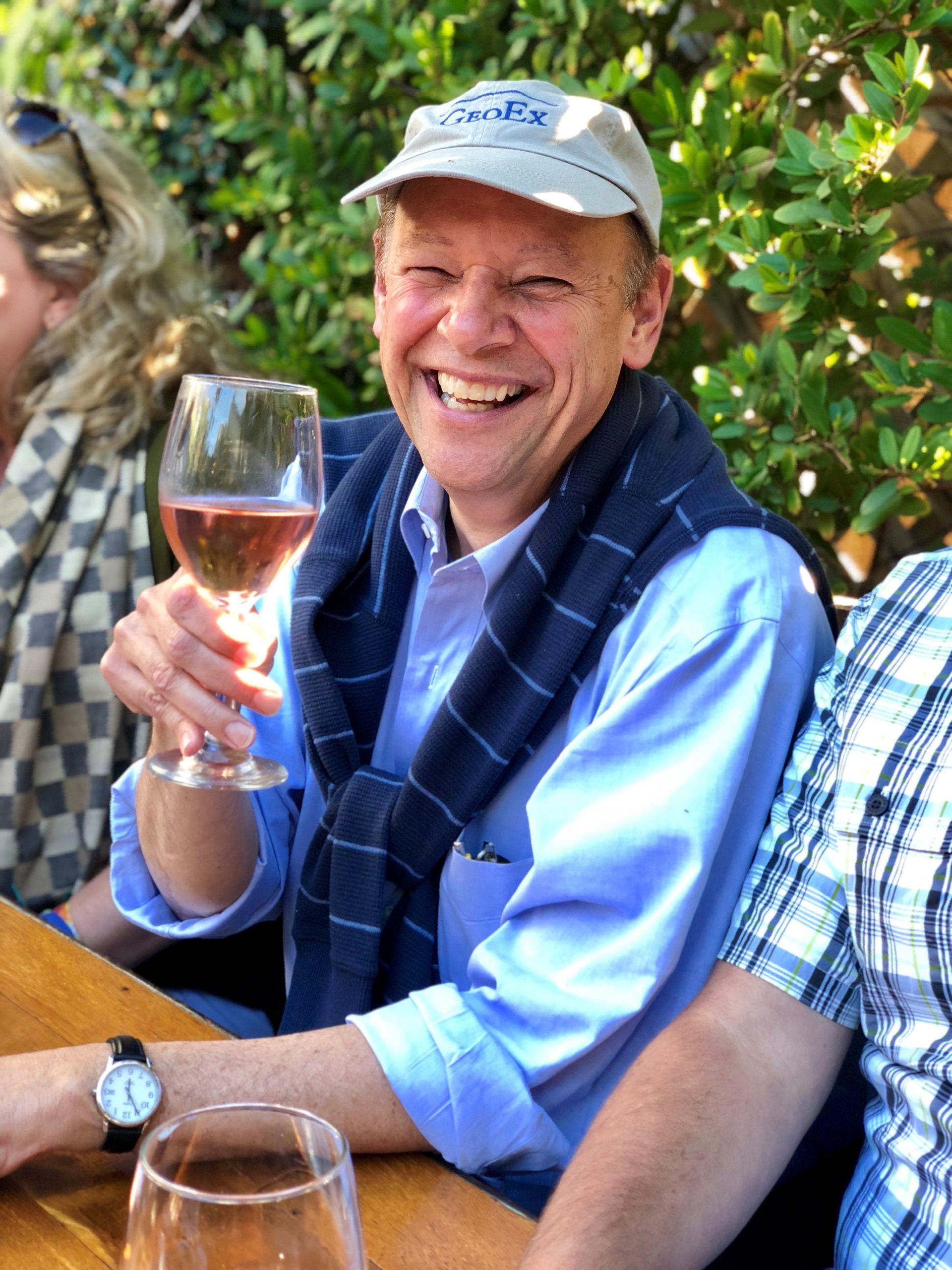 GeoEx Trip Leader raises a glass of wine