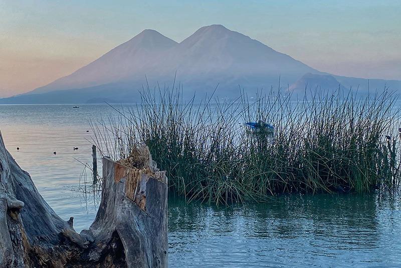 Volcanoes seen from the shores of Lake Atitlan at dawn, Guatemala