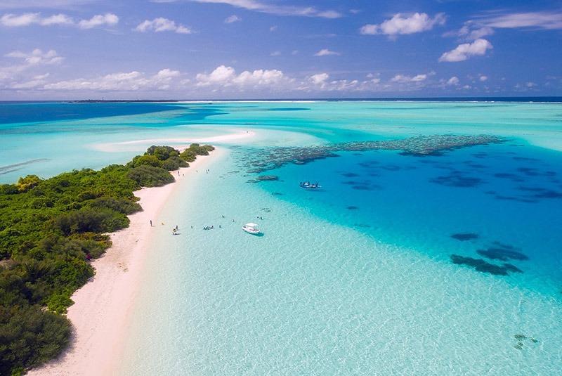 An aerial view of aqua waters and white sand beach, Maldives