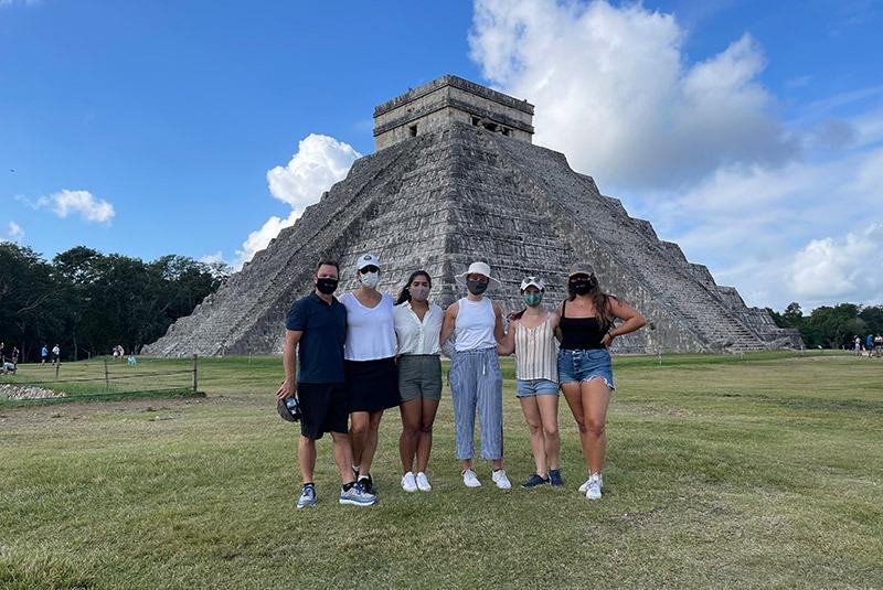 Family in front of El Castillo pyramid in Chichen Itza, Mexico