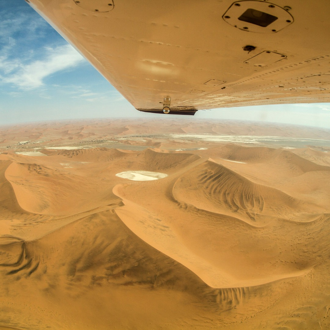 A sea of sand dunes seen from a safari flight over Namibia
