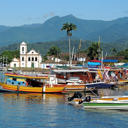 Boats and colonial architecture in the coastal town of Paraty, Brazil