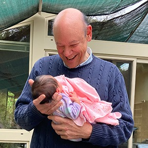 Don George with new granddaughter