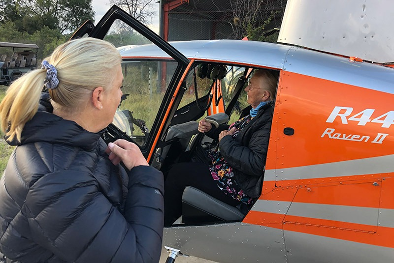 The Bert family traveling by helicopter in Botswana