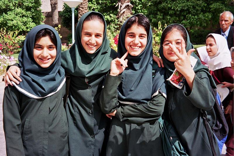 Smiling Iranian girls outside of Saadi teahouse, Iran