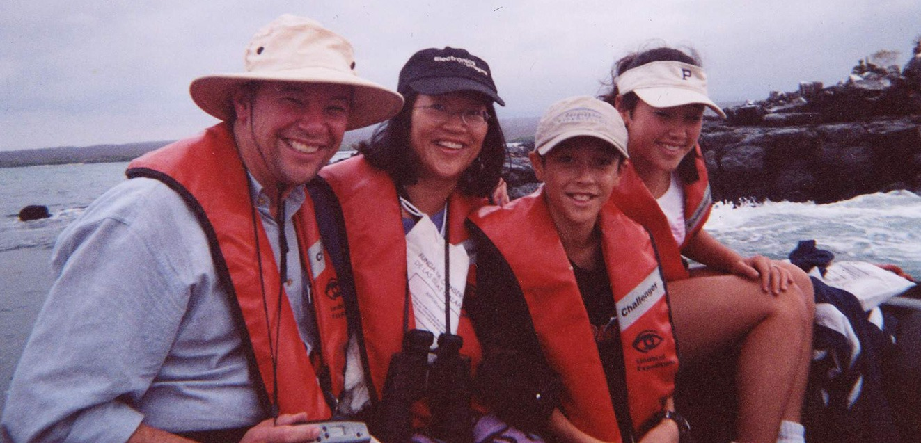 GeoEx's Don George with his family on a panga in the Galapagos Islands