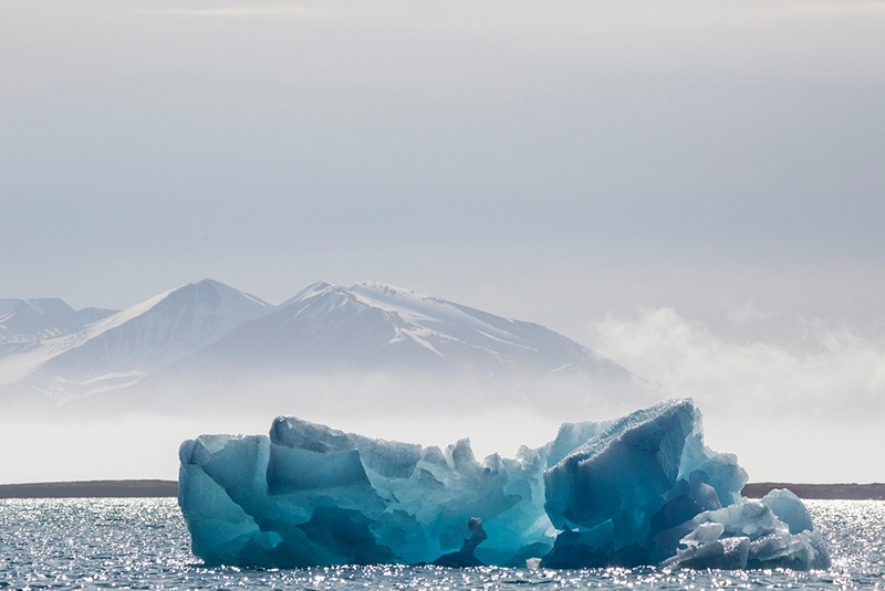 Blue glacial ice at sea in Svalbard, Norway