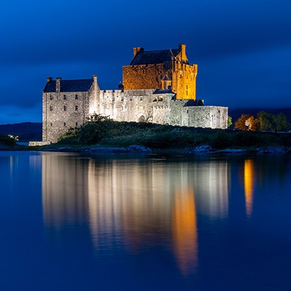 Eilean Donan castle lit up at night, Scotland