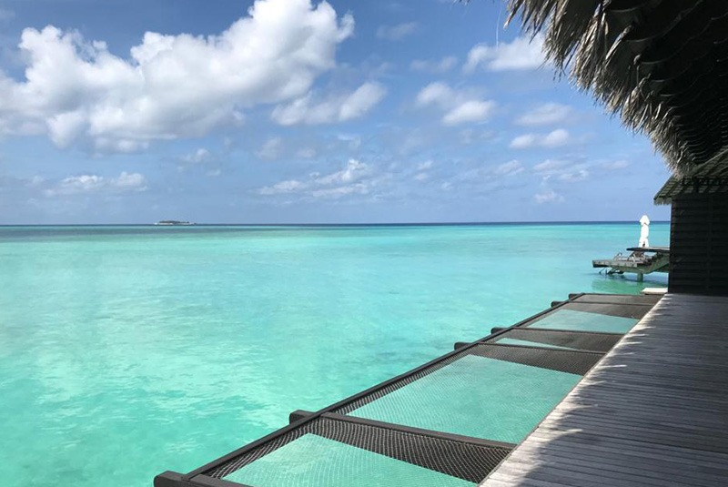 Looking out over turquoise waters from One&Only Reethi Rah, Maldives