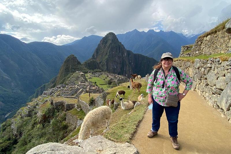 GeoEx staff member Tina Liadis at Machu Picchu, Peru