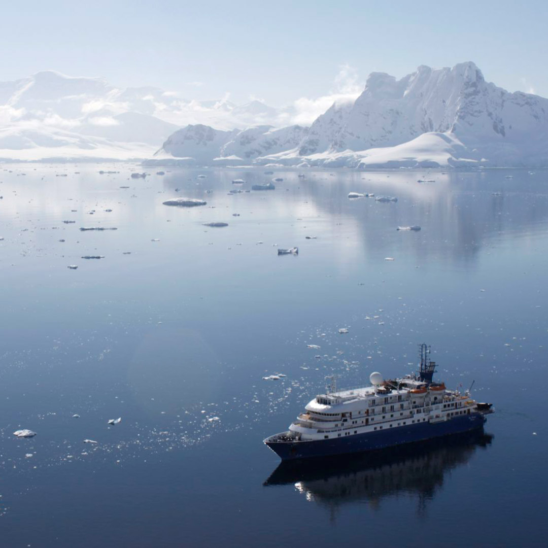 A cruise ship in the waters of Antarctica
