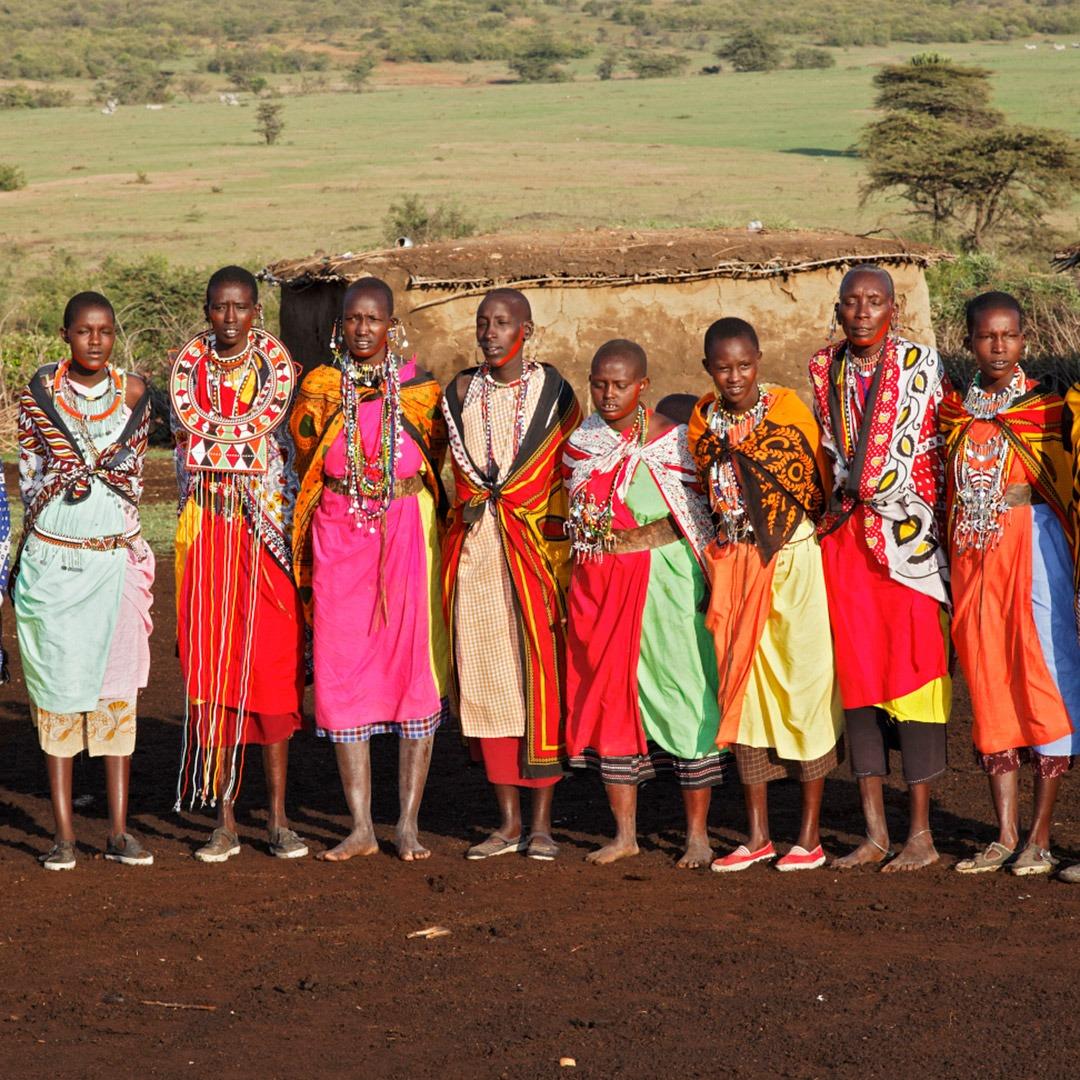 Colorfully dressed Maasai women in village, Kenya