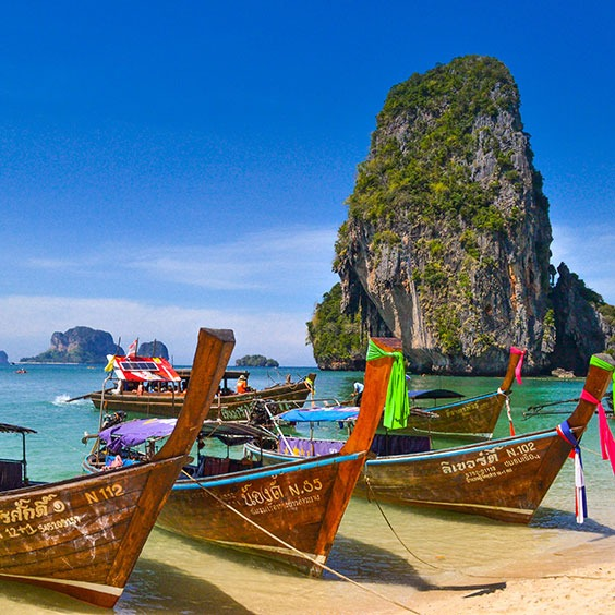 Traditional fishing boats and karsts in Krabi, Thailand